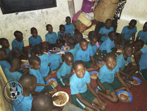 Orphan children fed by Save Omwana Africa at its community center