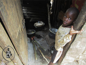 Orphan child showing the bad conditions of his shelter home