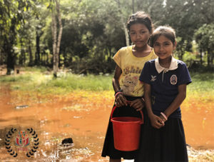 Cambodian girls in search of clean sanitized water